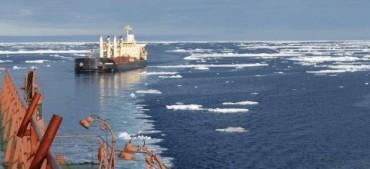 A vessel following an icebreaker in the Arctic Ocean © Tschudi Shipping