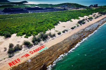 A protest banner near Abbot Point coal terminal. The extension of the port is under strong criticism from the NGO and the local community ©Tom Jefferson / Greenpeace