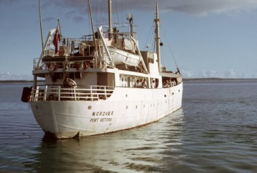 The MV Nordvaer departing East Point Plantation, Diego Garcia, 1968 © Kirby Crawford