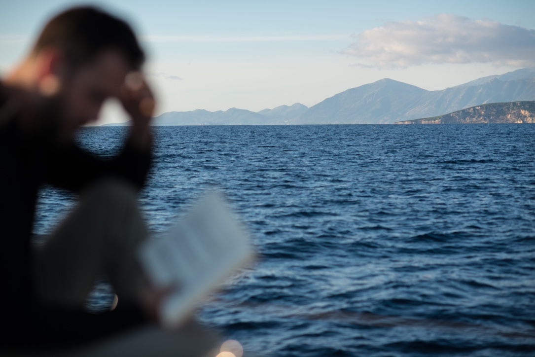 Aboard the sailing boat, the crew of OCEAN71 Magazine keeps studying the Odyssey right before reaching modern Ithaca © Philippe Henry / OCEAN71 Magazine