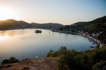 The sun is setting on the charming village of Vathy and its bay © Philippe Henry / OCEAN71 Magazine